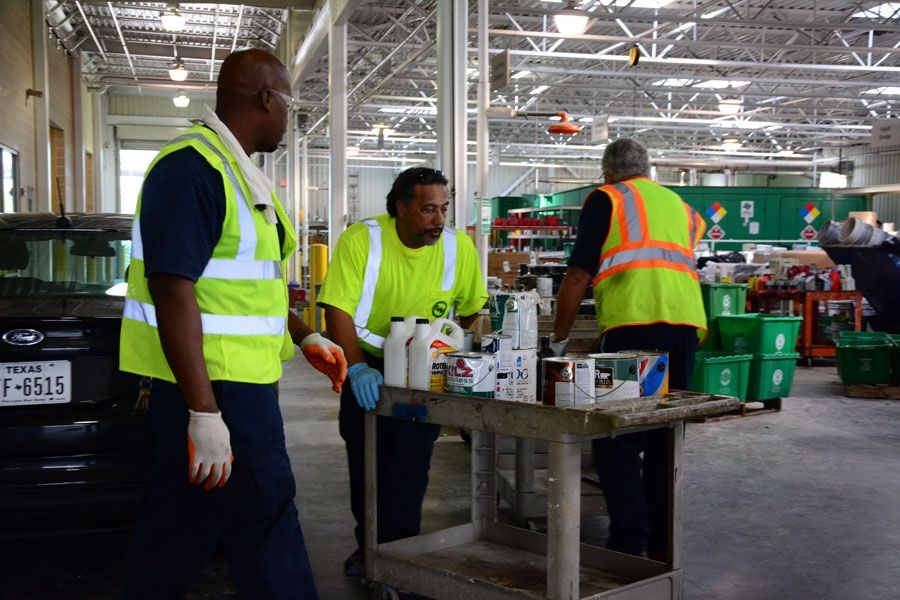 Chris Ford and his coworkers taking items to be seperated.