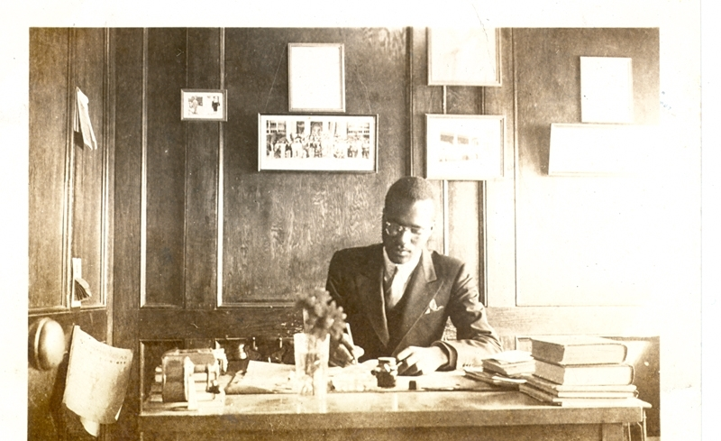The C.F. and Hortense Smith Collection  Unidentified man sitting at a desk.