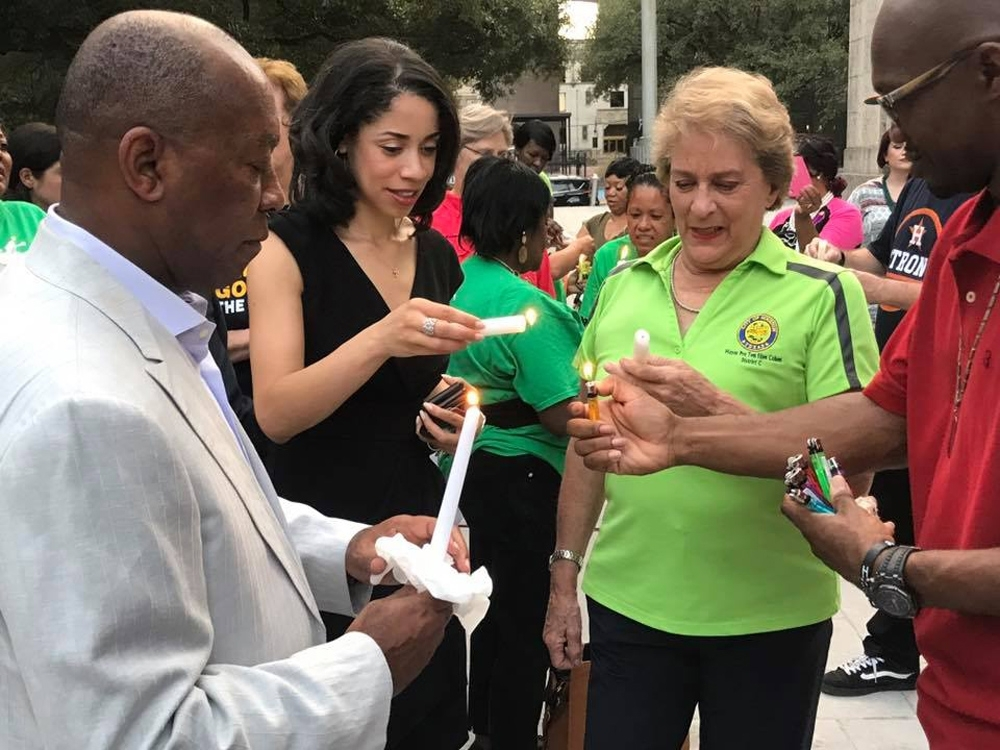 Mayor Sylvester Turner and City Council members Amanda Edwards and Ellen Cohen light candles at the Hope for Harvey prayer vigil. Photo courtesy of Mayor's Office of Communications
