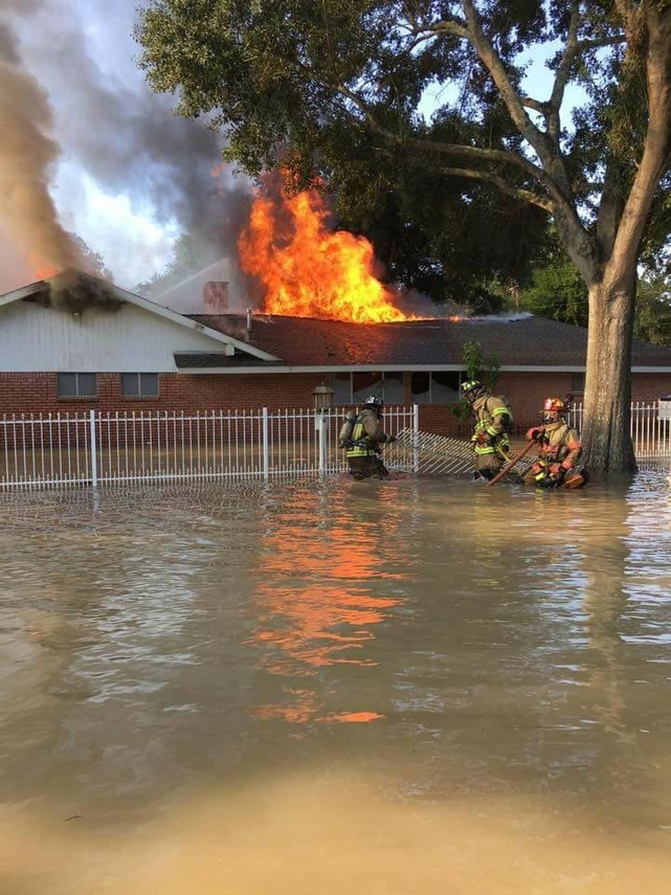HFD Firefighters respond to a fire in a flooded home. Photo courtesy of Station 49