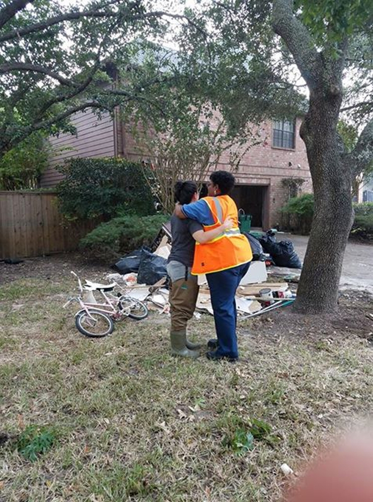 Solid Waste Supervisor Janice Simmons gives a warm embrace to an emotional resident as the crews remove childhood memories from the lawn of her parents' home. Photo courtesy of Solid Waste Management