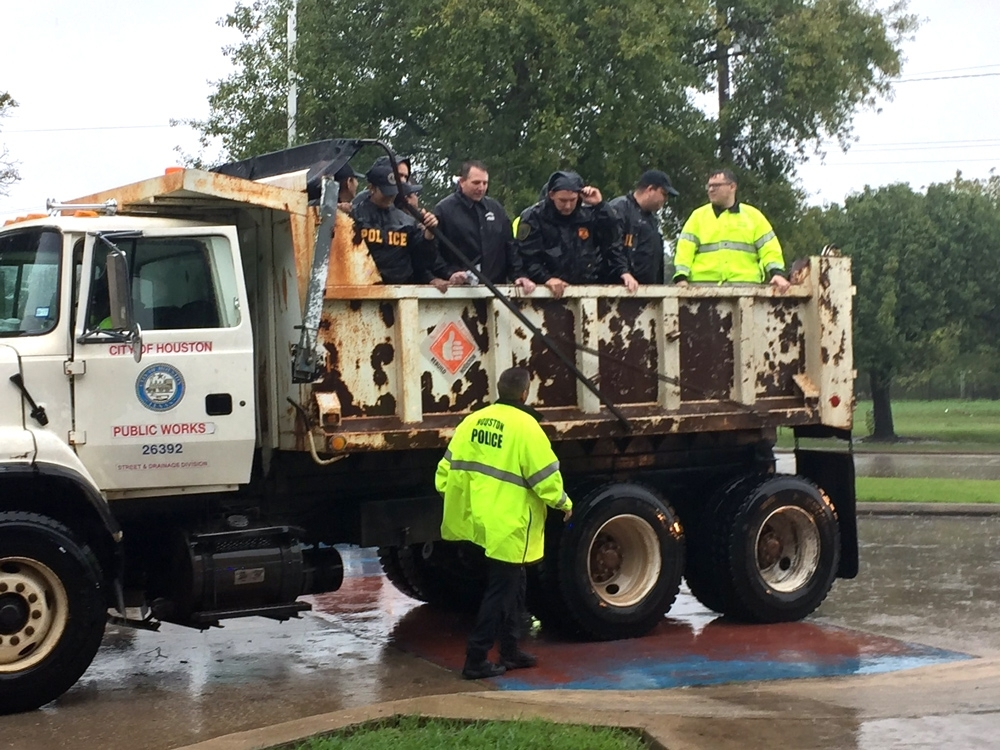 HPD officers ride in a Public Works truck to safely travel through high water areas. Photo courtesy of Public Works and Engineering.