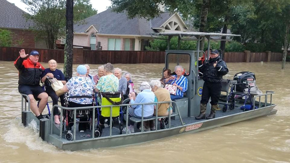 Public Works employees transport elderly on the high water barge.