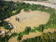 Aerial view of the flooded Turkey Creek/West wastewater treatment plant. Photo courtesy of Public Works and Engineering