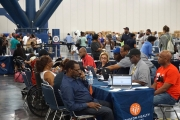Houston Health Department employees assist displaced residents at the George R. Brown Convention Center.