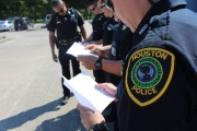 HPD officers read hand-written cards sent by elementary school students from North Dakota. Photo Courtesy of OEM