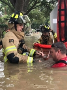 HFD firefighters wade through chest-high waters to rescue residents
