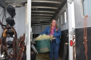 Corita Dubose prepares to feed her horses and mule. Corita owns Moose, Warrior and Muley among several other horses.