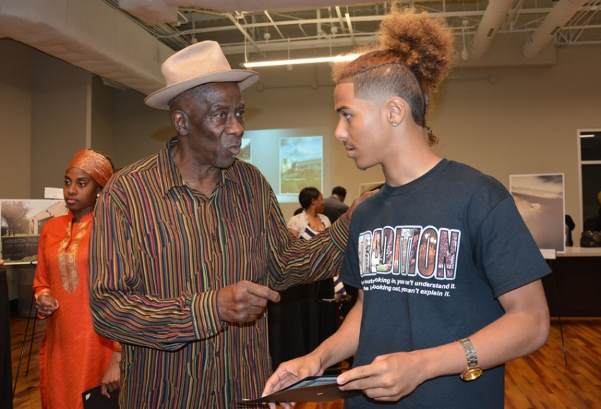 Omowale Allen offers advice to My Brother's Keeper Youth Council member Steven Anderson, on the eve of Anderson's graduation from Wheately High School.