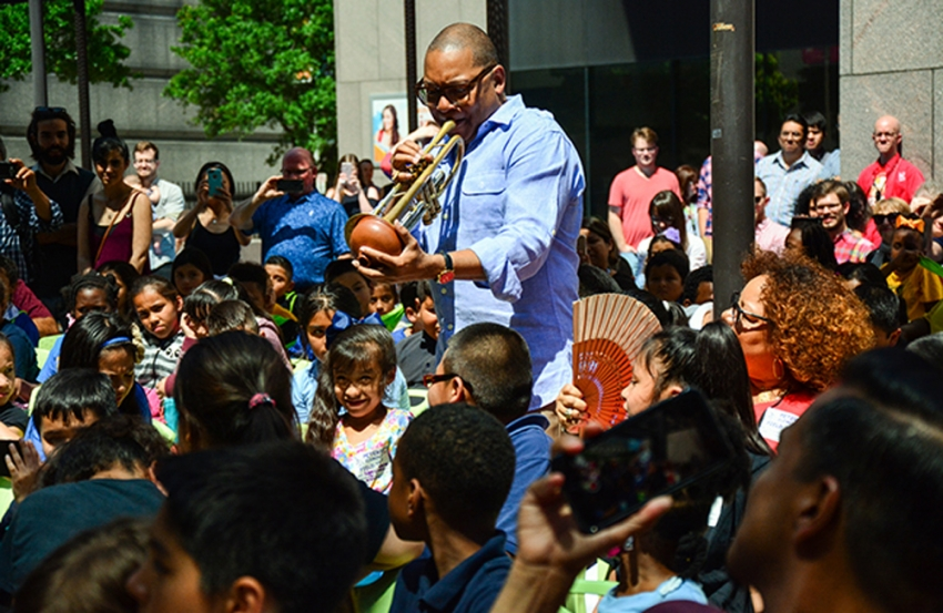 Wynton Marsalis plays to a crowd of elementary school students in the Barbara Bush Literacy Plaza in front of Central Library downtown.
