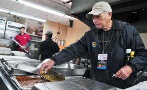 Joseph Raia, city of Houston sanitarian, tests food temperatures at the Houston rodeo.