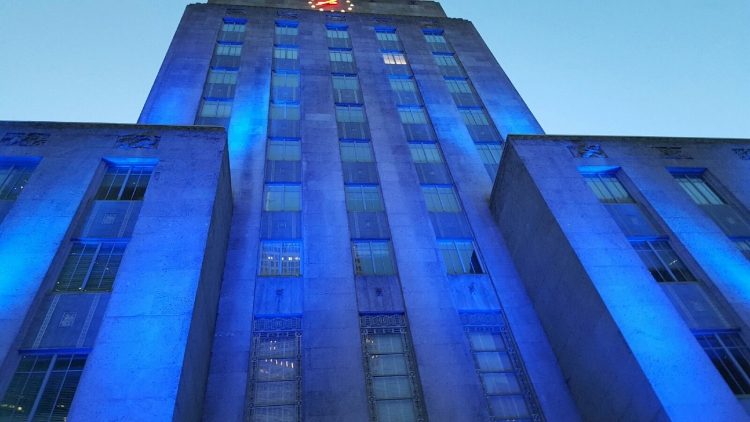 City Hall was bathed in blue light to show solidarity with Dallas police officers.