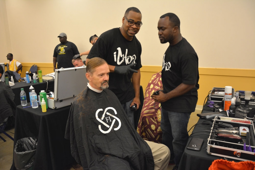 William Glasgow got a professional new look from Franklin Barber School at the Turnaround Houston Resource Fair on July 9.