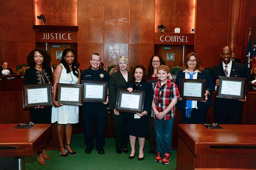 Mayor Annise Parker presented nine 2015 Bravo Awards to honor some of the city's most selfless employees — devoted to professionalism and customer service on the job and a spirit of volunteerism away from it. Shown with Parker are this year's recipients, from the left, Deborah Moore, E. Monique Johnson, Sam Buser, Tina Carkhuff and son, Sheila Blake, Maria Bolanos, Lester Whiteing, Jr. and Lisa Kimball (not pictured.)