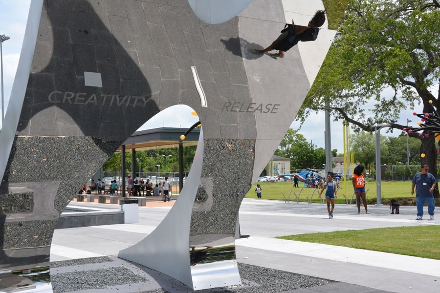 "One half of the polished stainless steel gateway arch is inscribed, ""Creativity and Release."""