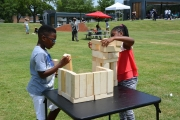 Children play games at the Emancipation Park rededication ceremony.