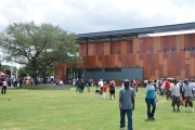 Emancipation Park visitors stroll the grounds in front of the newly redesigned gymnasium