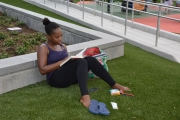 An Emancipation Park visitor takes a break to read in the shade.