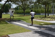 Young men practice their skateboarding moves at Emancipation Park.