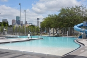 Emancipation Park's new swimming pool has a new water slide and views of downtown Houston.
