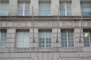 "The State National Bank building still bears the bank's original motto, ""Frugality is the mother of the virtues."""