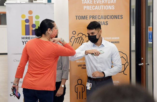 Luis Moreno (right) bumps elbows with Dr. Laura G. Murillo, president and Chief Executive Officer, Houston Hispanic Chamber of Commerce during the Hire Houston Youth 2021 Kickoff press conference.