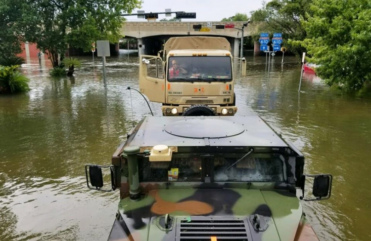 Texas National Guard soldiers arrive in Houston to aid citizens in areas of the city that became flooded when Hurricane Harvey dumped more than 50 inches of rain over the region.