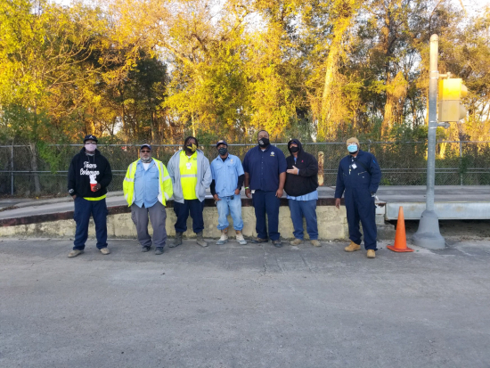 Members of Houston Public Works (from left to Right): James Coleman, Robert Mayfield, Anthony Franklin, Erik Ferrias, Demarkus Phipps, Carl Guevara, and Alvin Bhims were recognized for their outstanding work ethic in repairing the fence of Houston resident Lola Purvis.