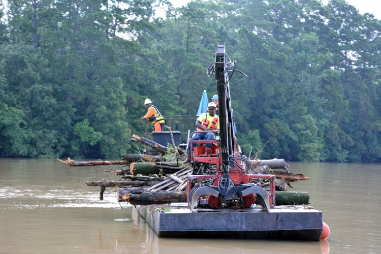 Solid Waste contractors use barges to haul storm and vegetative debris from Lake Houston.