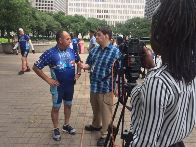 Rhys Griffin, a summer inter with HTV, interviews members of the Houston Police Department Bike Relay Team.