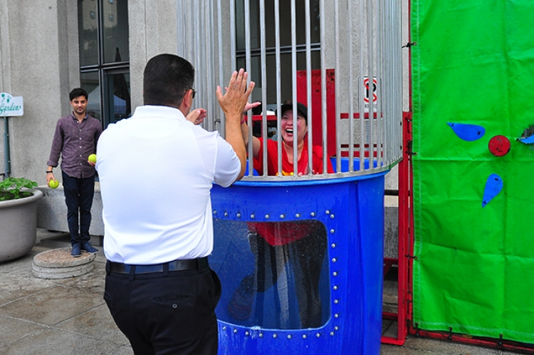 Houston Fire Department Chief Samuel Peña dunks Finance Director Tantri Emo for the Dunk the Director CMC fundraiser.
