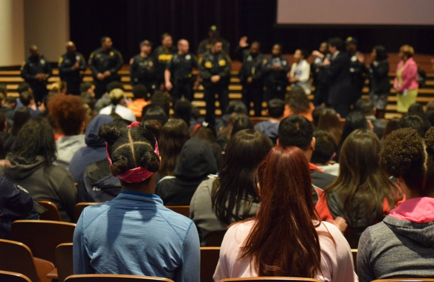 Houston police officers speak with Sam Houston High School students during the Peacekeepers training.