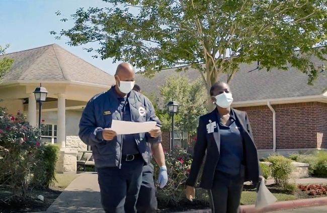 The Houston Health Department's Gabby Zamarripa is accompanied by Houston Fire Department personnel on an inspection of a local nursing home facility. The site visit is part of HHD and HFD's outreach program to help nursing homes be prepared for the coronavirus pandemic.
