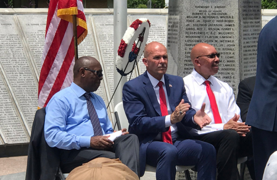 Steven Hall (center) director of the Mayor's Office for Veterans  and Military Affairs, sits between MOVMA Associate Dicrector Robert Dembo III (right) and Houston Mayor Sylvester  Turner (left) at a ceremony honoring veterans.