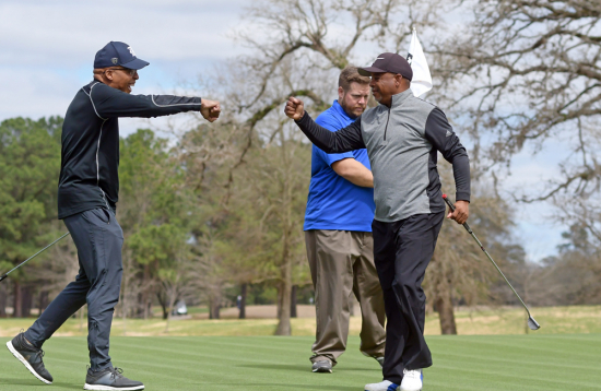 Golfers celebrate making a putt during the annual Houston Employee Relief Organization Golf Tournament at the newly renovated Houston Memorial Golf Course. The tournament raised more than $63,000 to help families of municipal employees killed in the line of duty.