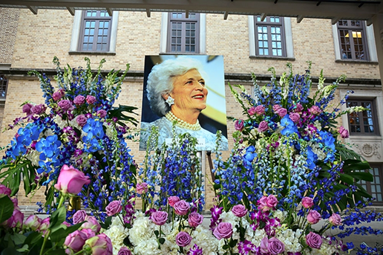 A spray of vivid flowers frames a portrait of former first lady Barbara Bush at the Houston Public Library downtown on April 19, two days after her death. The floral arrangement on HPL's Barbara Bush Literacy Plaza was part of the city's memorial celebrating her life and honoring her efforts to promote literacy.