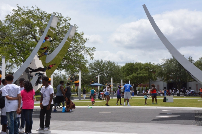 "A new decorative gateway arch inscribed with the words, ""Opportunity, Liberation, Creativity and Release,"" leads visitors Emancipation Park."